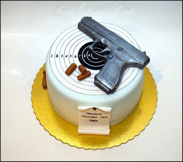 12 Groomsmen Cakes With A Gun Photo