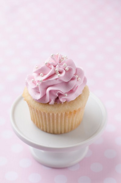 13 Cupcakes With Pink Icing Photo