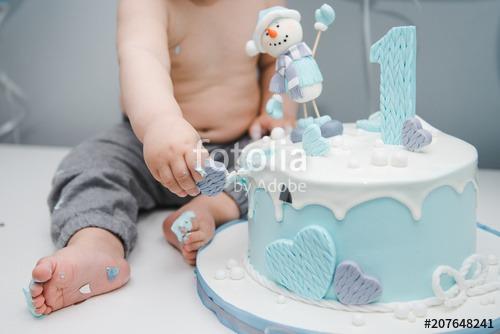 Kid's Feet Near The Cake  Cute Little Boy Eating His First